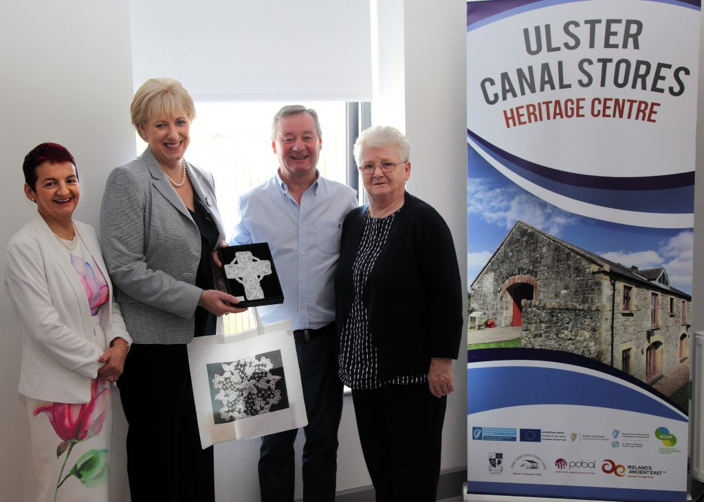 Presentation of a Clones Lace Celtic Cross to Minister Humphreys from Clones Development Society Chairman Michael Dowds. Manager Deirdre Kelly and maker of the Celtic Cross Mrs Alice Carey.