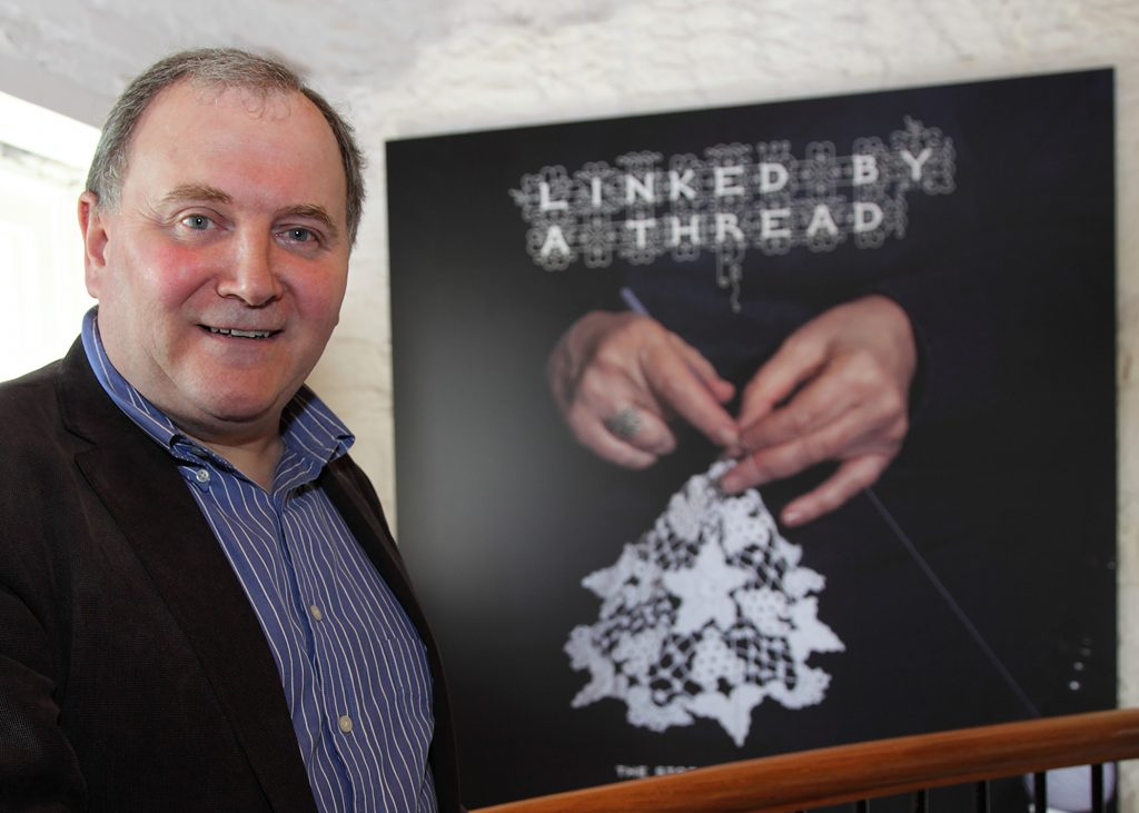 Eugene T Hamill in front of his 'Linked by a Thread' photograph.